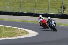 Motorcycle racing. Motorcycle on a race track royalty free stock photo