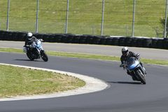 Motorcycle racing. Motorcycle turning on a curver of a race track stock images