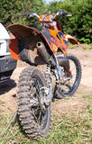 Motorcycle racing after the competition in motocross Stock Photos