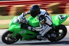 Motorcycle racing. High speed motorcycle makes the turn on the race track royalty free stock photos