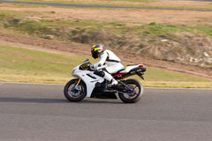 Motorcycle Racing. Race bike exiting out of a corner Royalty Free Stock Image