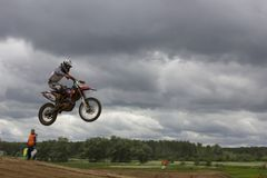 Racer is jumping. stock image