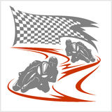 Motorcycle racing on the racetrack and checkered flag Stock Photography