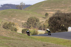Motorcycle Racing. Two superbikes under full power exiting out of a corner Royalty Free Stock Photo