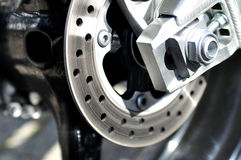 Motorcycle rear brake. Stock Photos