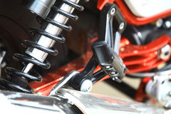 Motorcycle rear shock absorber. Color image of the rear shock absorber of a motorcycle Stock Images