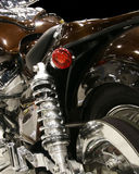 Motorcycle rear suspension. Close-up of the rear suspension and drive train of a roadster motorcycle Stock Photo