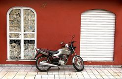 Motorcycle and red wall Stock Photo