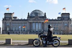 Motorcycle, Reichstag, and flags royalty free stock photography