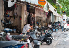 Motorcycle repair shop in Vietnam Stock Photo