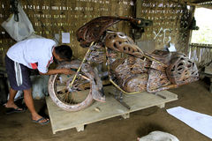 Motorcycle replica. Craftsmen are being made motorcycle replica of copper material in Boyolali, Central Java, Indonesia Stock Images