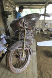 Motorcycle replica. Craftsmen are being made motorcycle replica of copper material in Boyolali, Central Java, Indonesia Royalty Free Stock Images
