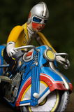 Motorcycle retro. A vintage tin toy motorcyle / bike with rider / biker Royalty Free Stock Images