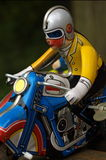 Motorcycle retro. A vintage tin toy motorcyle / bike with rider / biker Royalty Free Stock Photography