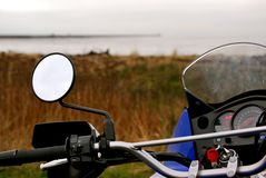 Motorcycle Ride. A Kawasaki KLR 650 parked near a trail, waiting to ride stock photo
