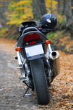 Motorcycle Ride. Motorcylce view from rear with helmet and tankbag Royalty Free Stock Photography