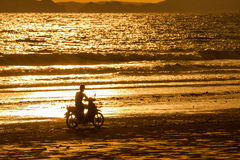 Motorcycle ride on the beach Stock Photo