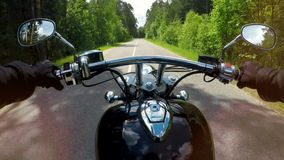 A motorcycle ride in the first view with handles, levers and mirrors visible. 4K. A motorcycle ride in the first view with handles, levers and mirrors visible stock video