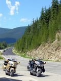 Motorcycle Ride in the Mountains. Two motorcyclists take a break in the Rocky Mountains in Canada Royalty Free Stock Photo