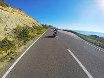 Motorcycle ride by the sea in Sardinia Stock Image