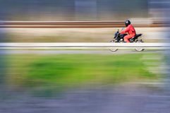 Motorcycle rider. A motorcycle rider captured at high speed stock images