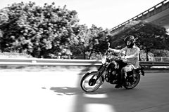 Motorcycle Rider. Biker taking a corner and making direct eye contact. Feeling the ride Stock Photos