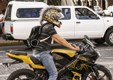 Motorcycle rider with decorative helmet. Royalty Free Stock Photo