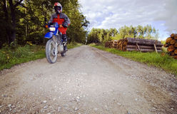 Motorcycle rider on dirt road. Motorcycle rider on a country dirt or gravel road stock images