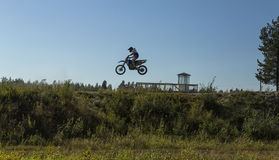 Motorcycle rider jumping Stock Photography