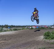 Motorcycle rider jumping Stock Images