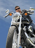 Motorcycle Rider Low Angle. Motorcycle Rider against blue sky Royalty Free Stock Photography