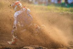 Motorcycle rider make huge dust splashed. During motocross race stock photos