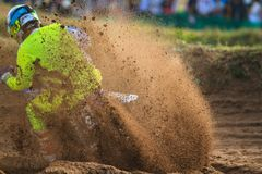 Motorcycle rider make huge dust splashed. During motocross race royalty free stock photos