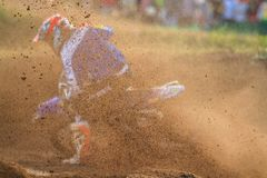 Motorcycle rider make huge dust splashed. During motocross race royalty free stock images