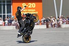 A motorcycle rider make wheelie on the bike Stock Image