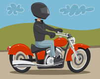 Motorcycle rider. Man riding motorcycle on road wearing helmet and leather Royalty Free Stock Photo