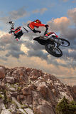 Motorcycle Rider Performing Aerial Stunt Stock Image
