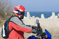 Motorcycle rider by sea Stock Images