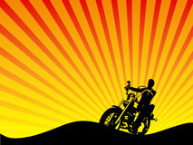 Motorcycle Rider Silhouette Vector. Vector image of the silhouette of a motorcylce rider blocking out the setting sun vector illustration