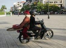 Motorcycle rider sits backwards Stock Images