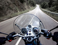 Motorcycle rider view. View from a motorcycle on road Stock Images