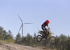Motorcycle rider and wind turbine Stock Photos