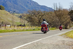 Motorcycle Riders. Two couples riding their motorcycle in a rural area Stock Photo