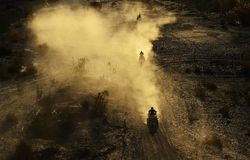 Motorcycle riders in morning desert stock photography