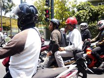 Motorcycle riders wait for the light to turn green at an intersection Royalty Free Stock Photography