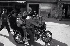 A motorcycle rides many people Stock Photo
