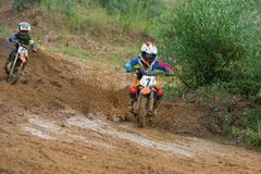 Motorcycle rides through the mud. MOSCOW, RUSSIA - JULY 1, 2017: Unrecognized young athletes, in the Velyaminovo Race Weekend 2017, Motopark Velyaminovo royalty free stock images