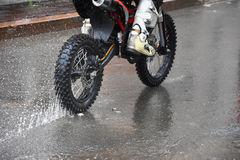 The motorcycle rides on the water with a spray Stock Image