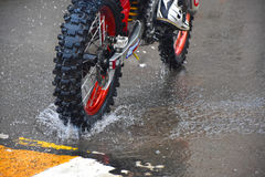 The motorcycle rides on the water with a spray Royalty Free Stock Photography