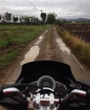 Motorcycle on the road. Motorcycle on farm road Royalty Free Stock Photography